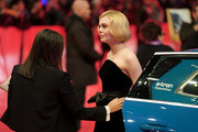 """Elle Fanning arrives for the """"The Roads Not Taken"""" premiere during the 70th Berlinale International Film Festival Berlin at Berlinale Palace on February 26, 2020 in Berlin, Germany."""