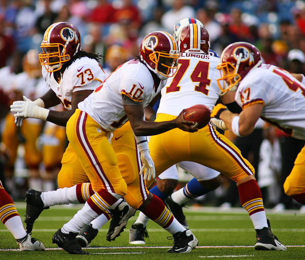 Robert Griffin III hands off to Chris Cooley