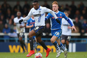 Kelvin Etuhu of Bury beats Callum Camps of Rochdale during The Emirates FA Cup Second Round match between Rochdale and Bury at Spotland on December 6, 2015 in Rochdale, England.