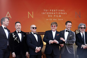 "(L-R) Giles Martin, David Furnish, Bernie Taupin, Sir Elton John, Taron Egerton and Director Dexter Fletcher attend the screening of ""Rocket Man"" during the 72nd annual Cannes Film Festival on May 16, 2019 in Cannes, France."