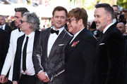 "(L-R) Richard Madden, Director Dexter Fletcher, Taron Egerton, Sir Elton John and David Furnish attend the screening of ""Rocket Man"" during the 72nd annual Cannes Film Festival on May 16, 2019 in Cannes, France."