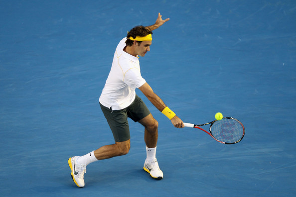 Roger Federer Roger Federer of Switzerland plays a backhand in his semifinal match against Novak Djokovic of Serbia during day eleven of the 2011 Australian Open at Melbourne Park on January 27, 2011 in Melbourne, Australia.