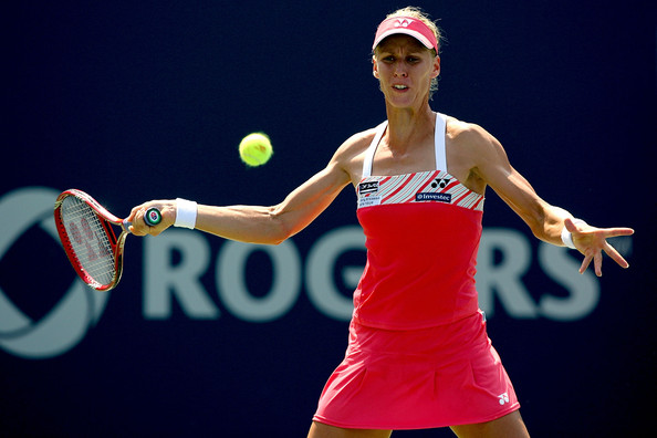 Elena Dementieva of Russia returns a shot to Shahar Peer of Israel during the Rogers Cup at the Rexall Center on August 20, in Toronto, Ontario, Canada.