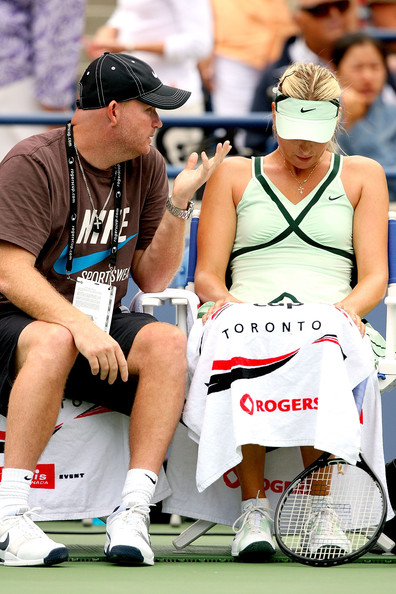 Michael Joyce Maria Sharapova of Russia confers with her coach Michale Joyce between sets against Elena Dementieva of Russia during the final of the Rogers Cup at the Rexall Center on August 23, 2009 in Toronto, Ontario, Canada.