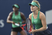 Eugenie Bouchard of Canada looks on while partner Sloane Stephens hits a return in their match against Kirsten Flipkens of Belgium and Daria Gavrilova of Russia on day four of the Rogers Cup at IGA Stadium on August 9, 2018 in Montreal, Quebec, Canada.
