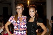 Nikki Poulos and Toni Trucks attend the Rolando Santana fashion show during Mercedes-Benz Fashion Week Spring 2014 at Center 548 on September 11, 2013 in New York City.