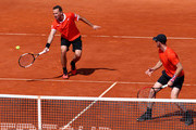 Jamie Murray of Great Britain and Bruno Soares of Brazil in action against Robin Haase and Wesley Koolhof of the Netherlands in their semifinal match during day seven of the Rolex Monte-Carlo Masters at Monte-Carlo Country Club on April 20, 2019 in Monte-Carlo, Monaco.