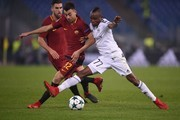 Qarabag's Haitian midfielder Donald Guerrier (R) fights for the ball with Roma's Italian striker Stephan El Shaarawy during the UEFA Champions League Group C football match AS Roma vs FK Qarabag on December 5, 2017 at the Olympic stadium in Rome.  / AFP PHOTO / Filippo MONTEFORTE