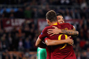 Edin Dzeko with his teammate L orenzo Pellegriniof AS Roma celebrates after scoring the opening goal during the Group G match of the UEFA Champions League between AS Roma and CSKA Moscow at Stadio Olimpico on October 23, 2018 in Rome, Italy.