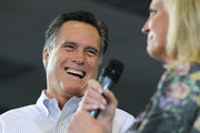 Republican presidential candidate and former Massachusetts Gov. Mitt Romney (L) laughs as his wife Ann Romney speaks during a campaign rally at Cleveland State University's Cole Center on March 2, 2012 in Cleveland, Ohio. After winning the Michigan and Arizona primaries, Mitt Romney is campaigning in Washington and Ohio ahead of the Super Tuesday primaries March 6.