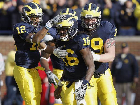 Wisconsin v Michigan [sports,sports gear,helmet,gridiron football,american football,football gear,team sport,canadian football,sprint football,ball game,denard robinson,perry dorrenstein,roy roundtree,michigan,wisconsin,wisconson,michigan wolverines,wisconsin badgers,touchdown,game]