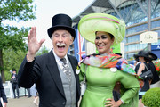 Presenter Bruce Forsyth and his wife Merced Wilnelia attend day one of Royal Ascot at Ascot Racecourse on June 17, 2014 in Ascot, England.