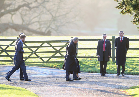 Prince Harry (L) and  Prince Charles, Prince of Wales arrives at the Christmas Day service at Sandringham on December 25, 2013 in King's Lynn, England.