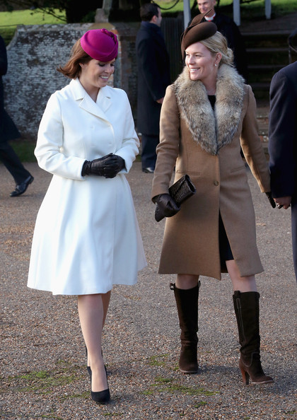 Princess Eugenie of York and Autumn Phillips leave the Christmas Day Service at Sandringham Church on December 25, 2014 in King's Lynn, England.