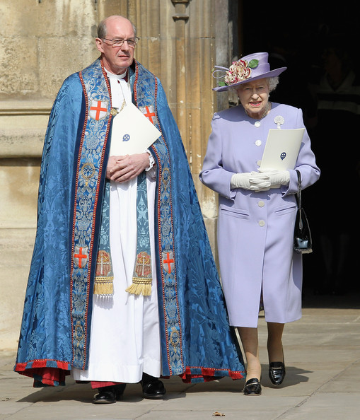 Queen Elizabeth II and the Dean of Windsor David Conner leave a thanksgiving service for the Queen Mother and Princess Margaret at St George's Chapel on March 30, 2012 in Windsor, England.
