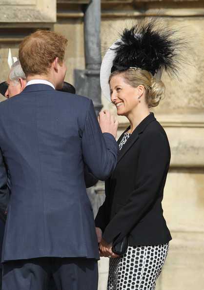 Prince Harry jokes with Sophie, Countess of Wessex as they arrive for a thanksgiving service for the Queen Mother and Princess Margaret at St George's Chapel on March 30, 2012 in Windsor, England.