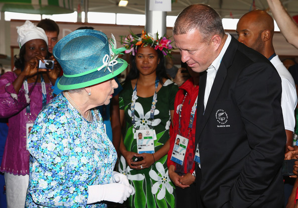 Queen Elizabeth II  is greeted by Tim Slyfield of New Zealand during a visit to the Athletes Village during the Commonwealth games on July 24, 2014 in Glasgow, Scotland.