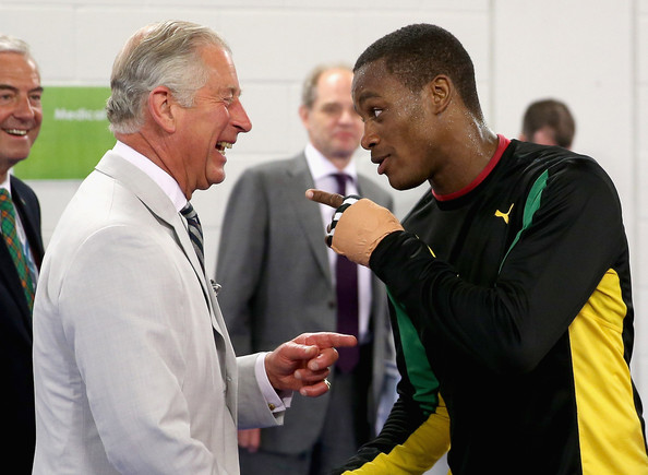 Prince Charles, Prince of Wales shares a joke with a member of the Jamaican Commonwealth Boxing Team as he visits the Emirates Arena and Chris Hoy Velodrome ahead of the start of the Commonwealth games on July 23, 2014 in Glasgow, Scotland.