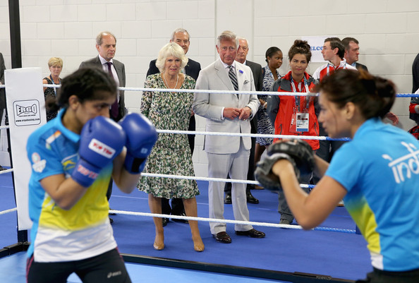 Prince Charles, Prince of Wales and Camilla, Duchess of Cornwall watch the Indian Women's Commonwealth Boxing Team train as they visit the Emirates Arena and Chris Hoy Velodrome ahead of the start of the Commonwealth games on July 23, 2014 in Glasgow, Scotland.