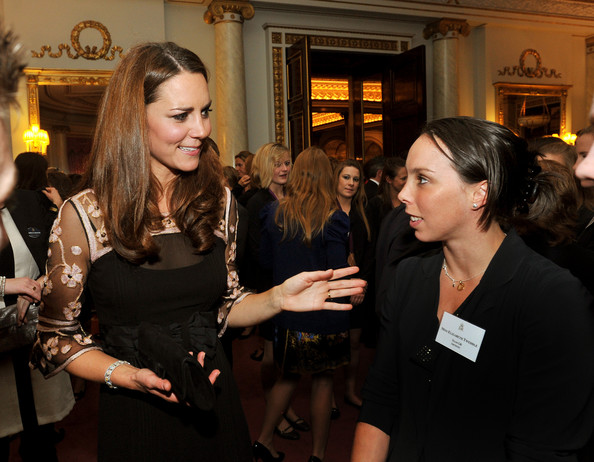 Catherine, Duchess of Cambridge talks to Gymnast Beth Tweddle (R) during a reception held for Team GB Olympic and Paralympic London 2012 medalists at Buckingham Palace on October 23, 2012 in London, England.
