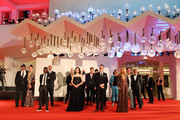 """Cast of the movie walk the red carpet ahead of the movie """"Run Hide Fight"""" at the 77th Venice Film Festival on September 10, 2020 in Venice, Italy."""