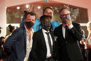 """Thomas Jane, Olly Sholotan, Joel Michaely and Director Kyle Rankin walk the red carpet ahead of the movie """"Run Hide Fight"""" at the 77th Venice Film Festival on September 10, 2020 in Venice, Italy."""