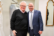 Ronnie Rothstein and Brian Cashman pose backstage as Runway Heroes Walk With The Yankees At Kleinfeld on June 18, 2019 in New York City.