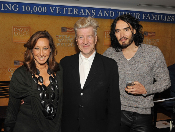 Russell Brand Designer Donna Karan, director and philanthropist David Lynch and actor/comedian Russell Brand attend The David Lynch Foundation's Operation Warrior Wellness launch press conference at the Paley Center For Media on December 13, 2010 in New York City.