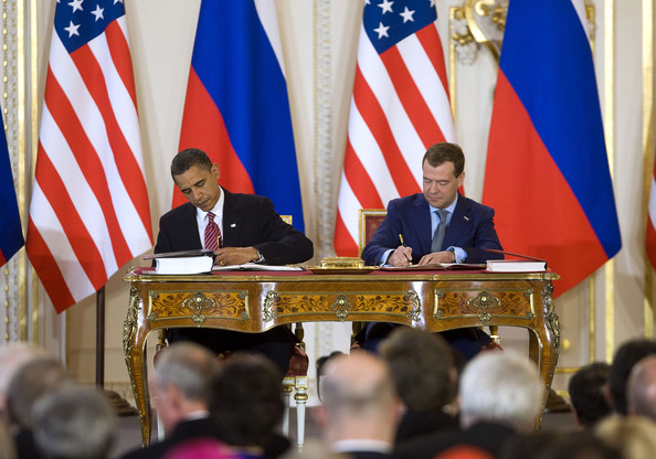 U.S. President Barack Obama (L) and Russian President Dmitry Medvedev sign the latest nuclear arms reduction treaty between the two countries, known as
