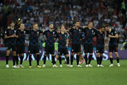 The Croatia players look on from the halfway line as Mateo Kovacic of Croatia misses his team's second penalty in the penalty shoot out during the 2018 FIFA World Cup Russia Quarter Final match between Russia and Croatia at Fisht Stadium on July 7, 2018 in Sochi, Russia.