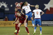 Nadezhda Karpov #6 of Russia heads the ball over Becky Sauerbrunn #4 of the U.S. during the second half of the International Friendly soccer match at Toyota Stadium on April 6, 2017 in Frisco, Texas.