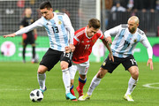 From L: Argentina's Matias Kranevitter, Russia's forward Fedor Smolov and Argentina's Javier Mascherano vie for the ball during an international friendly football match between Russia and Argentina at the Luzhniki stadium in Moscow on November 11, 2017. / AFP PHOTO / Mladen ANTONOV