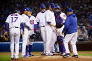 Manager Joe Maddon of the Chicago Cubs relieves Jon Lester #34 in the eighth inning during game four of the National League Division Series against the Washington Nationals at Wrigley Field on October 11, 2017 in Chicago, Illinois.