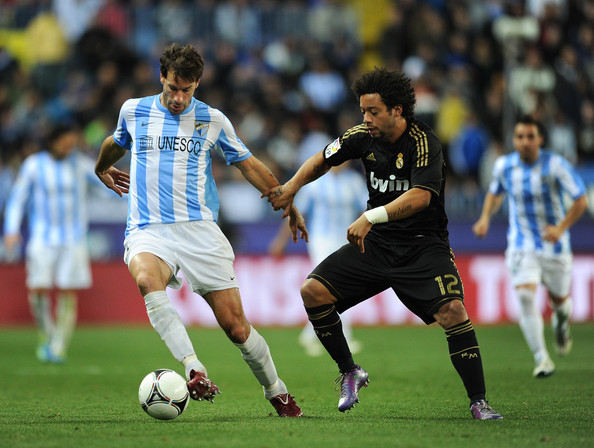 Malaga v Real Madrid - Copa del Rey [player,sports,soccer player,sports equipment,football player,team sport,sport venue,ball game,football,soccer,marcelo,ruud van nistelrooy,v,round,l,ball,malaga,spain,real madrid,copa del rey second leg match between malaga]