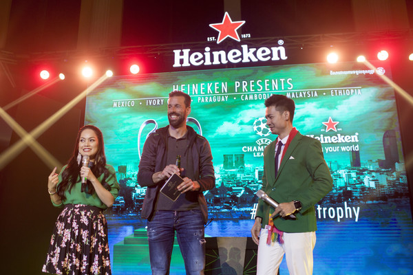 UEFA Champions League Trophy Tour presented by Heineken - Phnom Penh [green,event,performance,stage equipment,technology,music,stage,talent show,performing arts,world,ruud van nistelrooy,stage,phnom penh,center,cambodia,heineken,uefa champions league trophy tour]