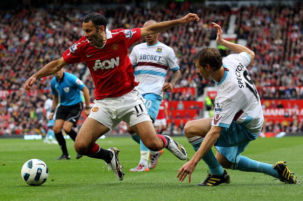 Ryan Giggs Jonathan Spector of West Ham United brings down Ryan Giggs of Manchester United to concede a penalty during the Barclays Premier League match between Manchester United and West Ham United at Old Trafford on August 28, 2010 in Manchester, England.