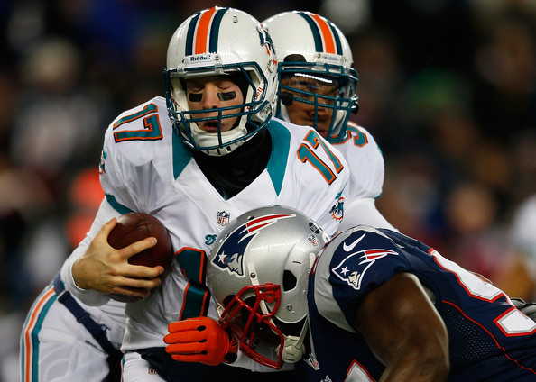 Miami Dolphins v New England Patriots [miami dolphins,new england patriots,sports gear,sports,helmet,sports equipment,team sport,football gear,player,football equipment,personal protective equipment,gridiron football,foxboro,massachusetts,gillette stadium,ryan tannehill,justin francis]