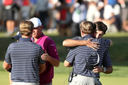 Webb Simpson (L) and Bubba Watson of the USA are greeted by USA team captain Davis Love III on the 14th green after the team of Simpson/Watson defeated the team of Rose/Molinari 5&4 during day two of the Afternoon Four-Ball Matches for The 39th Ryder Cup at Medinah Country Club on September 29, 2012 in Medinah, Illinois.
