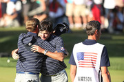 Webb Simpson (L) and Bubba Watson of the USA hug on the 14th green after defeating the team of Rose/Molinari 5&4 during day two of the Afternoon Four-Ball Matches for The 39th Ryder Cup at Medinah Country Club on September 29, 2012 in Medinah, Illinois.