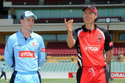 Peter Nevill of the Blues and Johan Botha of the Redbacks take part in the coin toss before the Ryobi One Day Cup match between the South Australian Redbacks and the New South Wales Blues at Adelaide Oval on February 17, 2013 in Adelaide, Australia.