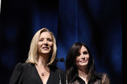 (L-R) Lisa Kudrow and Courteney Cox speak onstage during SAG-AFTRA Foundation's 4th Annual Patron of the Artists Awards at Wallis Annenberg Center for the Performing Arts on November 07, 2019 in Beverly Hills, California.