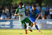 Francisco da Silva Caiuby of Augsburg and Christos Nikiforidis of Olching compete for the ball during the pre-season friendly match between SC Olching and FC Augsburg on July 19, 2018 in Olching, Germany.