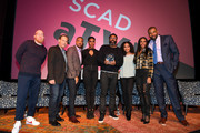 "(L-R) Marvin ""Krondon"" Jones III, James Remar, Damon Gupton, Christine Adams, Salim Akil,  China Anne McClain, Nafessa Williams, and Cress Williams pose with the 2018 aTVfest Spotlight Audience Award during a screening and Q&A for 'Black Lightning' on Day 3 of the SCAD aTVfest 2018 on February 3, 2018 in Atlanta, Georgia."