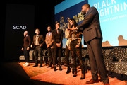 "(L-R) Marvin ""Krondon"" Jones III, James Remar, Damon Gupton, Christine Adams, China Anne McClain, Nafessa Williams, and Cress Williams speaks during a screening and Q&A for 'Black Lightning' on Day 3 of the SCAD aTVfest 2018 on February 3, 2018 in Atlanta, Georgia."