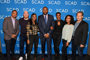 "(L-R) Damon Gupton, Marvin ""Krondon"" Jones III, Nafessa Williams, Cress Williams, Christine Adams, China Anne McClain, and James Remar pose with the 2018 aTVfest Spotlight Cast Award for 'Black Lightning' on Day 3 of the SCAD aTVfest 2018 on February 3, 2018 in Atlanta, Georgia."