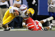 Cornelius Washington #83 of the Georgia Bulldogs is penalized for a horse-collar tackle on Jordan Jefferson #9 of the LSU Tigers during the 2011 SEC Championship Game at Georgia Dome on December 3, 2011 in Atlanta, Georgia.