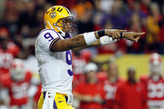 Quarterback Jordan Jefferson #9 of the LSU Tigers runs gestures as he directs the offense against the Georgia Bulldogs in the first quarter during the 2011 SEC Conference Championship at  Georgia Dome on December 3, 2011 in Atlanta, Georgia.