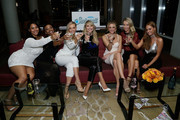 (L-R) Models Tabria Majors, Iyonna Fairbanks, Camille Kostek, Christie Brinkley, Allie Ayers, Olivia Jordan and Haley Kalil attend the SI Swimsuit 2018 Model Search celebration and preview of the Sports Illustrated Swim and Active Collection at Mr. Purple in Hotel Indigo LES November 1, 2017 in New York City.