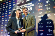 Sports journalist Mark Ogden of The Telegraph  (L) received Sports Scoop Award from Tony Adams during the SJA British Sports Journalism Awards Ceremony at Grand Connaught Rooms on March 24, 2014 in London, England.