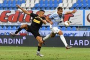 Alexis Sanchez of FC Internazionale  competes for the ball with Thiago Cionek of SPAL during the Serie A match between SPAL and FC Internazionale at Stadio Paolo Mazza on July 16, 2020 in Ferrara, Italy.